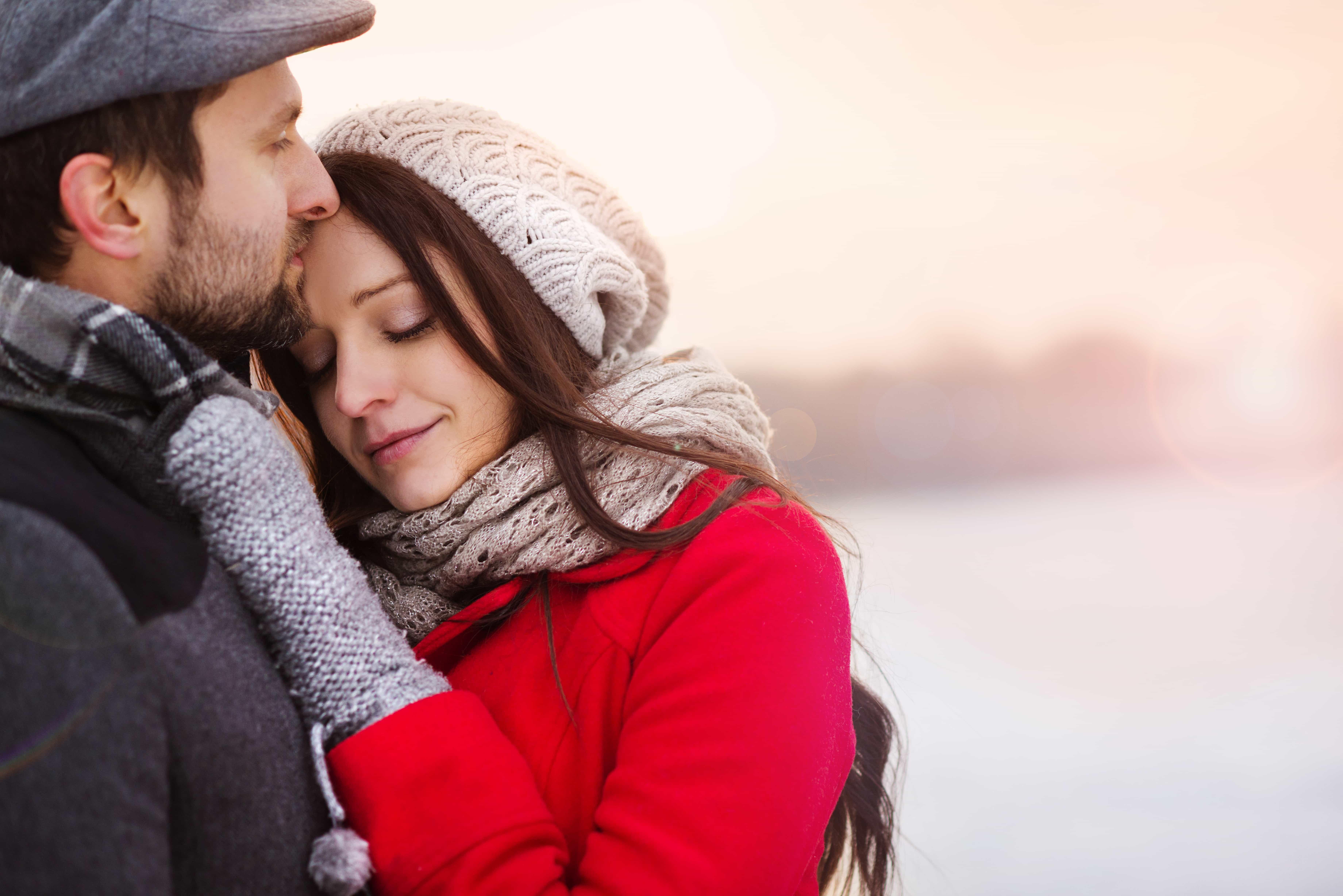 Winter couple hugging