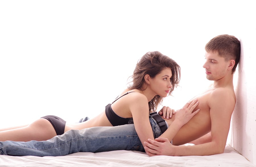 Young loving couple isolated on white