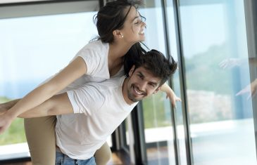 romantic happy young couple relax at modern home indoors and hav