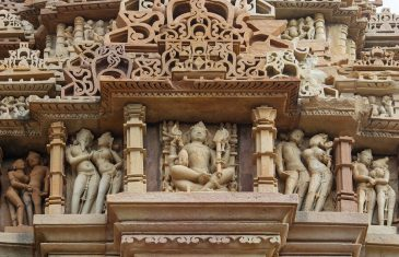 Stone carved erotic bas relief in Hindu temple in Khajuraho, India. Unesco World Heritage Site Stone carved erotic bas relief in Hindu temple in Khajuraho, India. Unesco World Heritage Site