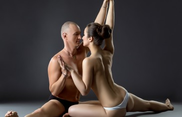 Sexual yoga. Seminude partners posing close to each other