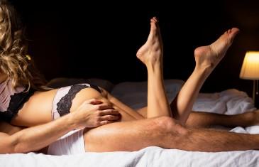 Sensual man and woman having sex in bedroom