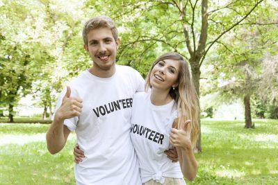 couple of teenagers volunteering outdoor in the park