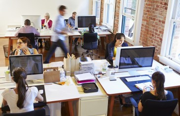 Wide Angle View Of Busy Design Office With Workers At Desks