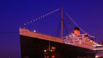 LOS ANGELES - August 20: Queen Mary and Russian Scorpion homeported on August 20 2009 in Long Beach Los Angeles California USA.